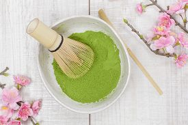 stock photo of bamboo  - Still life with green matcha tea powder and bamboo whisk - JPG