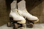 picture of roller-skating  - Old worn roller skates with big shoe - JPG
