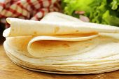 picture of whole-wheat  - stack of homemade whole wheat flour tortillas on a wooden table - JPG