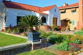picture of drought  - Spanish style home with a drought tolerant front yard taken in a California neighborhood - JPG