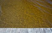 stock photo of sedimentation  - Yellow ocean water discolored by clean sediments from the Atran river nearby - JPG