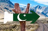 pic of skardu  - Pakistan Flag wooden sign with desert road background - JPG