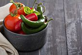 stock photo of red hot chilli peppers  - Green and red hot pepper in a bowl - JPG