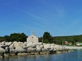 picture of graveyard  - The Krijal church with the graveyard situated at the harbor of the little island Premuda in the northern Adriatic sea of Croatia - JPG