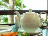 picture of teapot  - white teapot on tea party on the nature - JPG