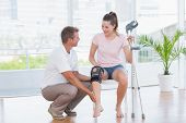 picture of knee  - Doctor examining his patient knee in medical office - JPG