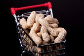 foto of trolley  - unshelled peanuts in the supermarket trolley on black background - JPG