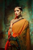picture of indian beautiful people  - Young beautiful woman in bright Indian costume - JPG