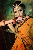 stock photo of indian beautiful people  - Young beautiful woman in bright Indian costume - JPG