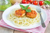 picture of meatball  - Meatballs in tomato sauce with spaghetti on a white plate - JPG