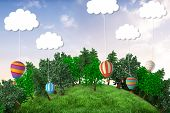 picture of cloud forest  - Sphere covered with forest against hot air balloons hanging from clouds - JPG
