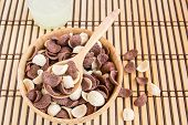 image of cereal bowl  - Close up sweet cereal in wooden bowl on wood background - JPG