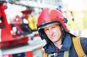 pic of firemen  - firefighter in uniform in front of fire engine machine and fireman team - JPG