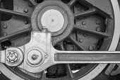 pic of locomotive  - big wheel of black color a closeup of the old locomotive with the steam engine - JPG