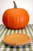 stock photo of pumpkin pie  - Festive pumpkin and pie for autumn holidays - JPG