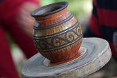 stock photo of pottery  - An artist makes a clay vase on a pottery wheel in Costa Rica - JPG