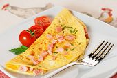 stock photo of cilantro  - omelette with ham cherry tomatoes and cilantro - JPG