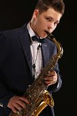 image of sax  - Top saxophonist playing sax during a live jazz session - JPG