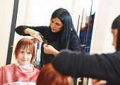 foto of beauty parlour  - Stylist cutting hair of a female client at the beauty salon - JPG