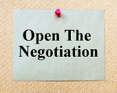 picture of negotiating  - Open The Negotiation written on paper note pinned with red thumbtack on wooden board - JPG