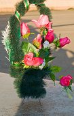 picture of rose close up  - Wreath with roses on a granite slab - JPG