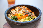 stock photo of korean  - Korean tranditional bibimbap in a stone pot - JPG
