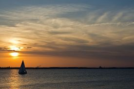 stock photo of maryland  - A sailboat on the Chesapeake bay in Maryland at sunset  - JPG