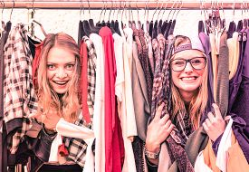 picture of stall  - Young hipster women at clothes flea market  - JPG