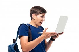 foto of disgusting  - Male student with disgusted emotion holding laptop isolated on a white background - JPG