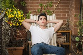 picture of v-day  - Handsome young man in balcony day - JPG