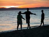 foto of reunited  - friends reuniting on the beach at sunset - JPG