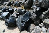 image of obsidian  - Obsidian boulders from lava flow volcanic eruption Newberry National Volcanic Monument Central Oregon - JPG
