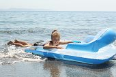 Girl On  Inflatable Mattress In Sea