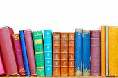 image of book-shelf  - Used grunge colourful books at library shelf - JPG