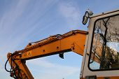 stock photo of jcb  - Hydraulic Arm rams and cab on a construction site digger - JPG