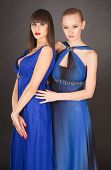 pic of saxy  - Two young girls in elegant blue dresses studio isolated shot - JPG