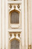 stock photo of charminar  - Nijam style windows on historic 400 year old charminar in India - JPG