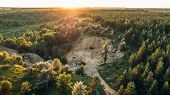Mining Quarry With Bulldozer Machinery Among Forest, Flying Above View Or Top View, Toned poster