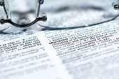 stock photo of glossary  - Close up view of a business word defition in a dictionary - JPG