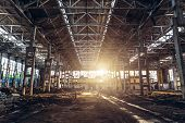 Abandoned Ruined Industrial Factory Building, Corridor View With Columns, Perspective And Sunlight,  poster