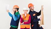Men And Woman In Helmets Carefree With Hammer And Project, White Background. Inspector Disappointed  poster