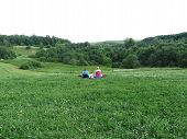 Leisure On A Nature. Two Girls Sitting On The Grass, European Country Scenic Landscape With Summer F poster