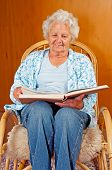 foto of broad-bodied  - Portrait of a senior woman in rocking chair - JPG