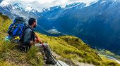 Traveler Resting And Watching The View Around Him. Cascade Saddle, Mount Aspiring National Park, New poster