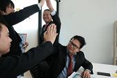 Business Co-worker Team Raise Hands With Happiness For Successful Project. Cheerful Asian Businessma poster