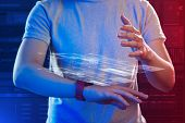 Transparent Hologram. Careful Experienced It Manager Standing With A Smart Watch On His Wrist And Pu poster