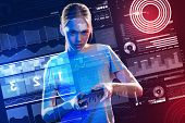 Modern Video Games. Calm Serious Young Girl Standing With A Game Console And Looking Concentrated Wh poster