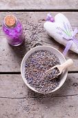 Dry Lavender Buds Bowl, Salt With Lavender Oil And Sachet With It On Vintage Wooden Background. Sele poster