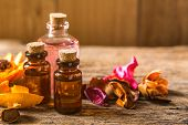 Bottle Of Aroma Essential Oil Or Spa Or Natural Fragrance Oil With Dry Flower On Wooden Table, Spa O poster