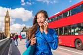 London city businesswoman calling on mobile phone poster